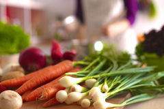 Pile of organic vegetables on a wooden table Royalty Free Stock Photo
