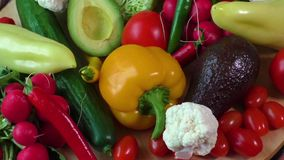 Pile of organic vegetables on a wooden table stock video
