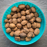Pile of organic walnuts in a bowl, close up Royalty Free Stock Images