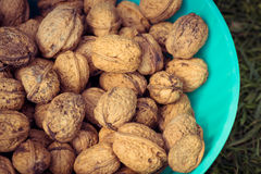 Pile of organic walnuts in a bowl, close up, clean eating concept Royalty Free Stock Images