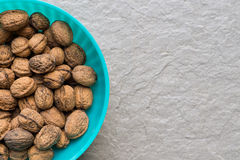Pile of organic walnuts in a bowl, close up, clean eating concept Royalty Free Stock Photo