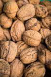 Pile of organic walnuts close up, clean eating concept Royalty Free Stock Photo