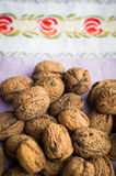 Pile of organic walnuts on vintage kitchen cloth Royalty Free Stock Images