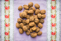 Pile of organic walnuts on vintage kitchen cloth Stock Photo