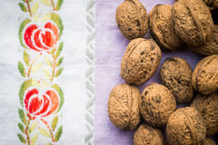 Pile of organic walnuts on vintage kitchen cloth, clean eating concept Royalty Free Stock Photo