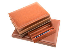 Pile of organizers and pen in  wooden case Royalty Free Stock Image