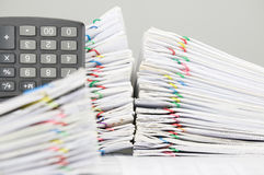 Pile overload document and calculator have blur paperwork as foreground Stock Photography