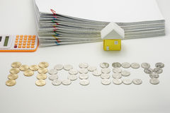 Pile overload document with colorful paperclip. And house and calculator with gold and silver coins on white background stock image
