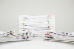 Pile overload document have blur pile paperwork around. Pile overload document of receipt and report with colorful paperclip have blur pile paperwork around on Stock Photo