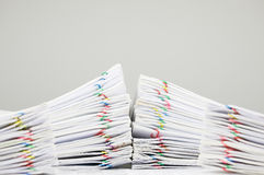 Pile overload document have blur pile paperwork on foreground. Pile overload document of receipt and report with colorful paperclip on finance account have blur Royalty Free Stock Photo
