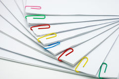 Pile overload document of report with colorful paperclip. On white background royalty free stock photos