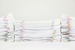 Pile overload document of report and receipt on white background Royalty Free Stock Photos
