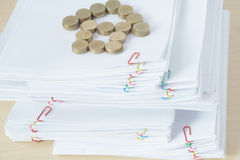 Pile of overload paper have blur gold coins place as house Stock Photos