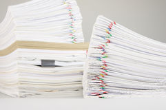 Pile overload paper have blur pile document as background. Pile overload paper of receipt and report with colorful paperclip have blur pile document and brown Stock Images