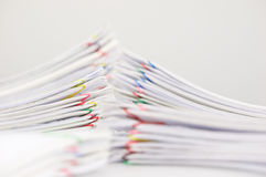 Pile overload paper on white table Royalty Free Stock Photos