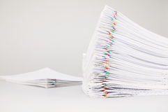 Pile overload paperwork with colorful paperclip with blur pile document Royalty Free Stock Images