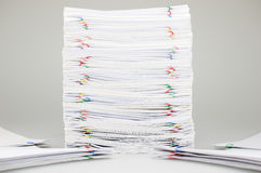 Pile overload paperwork have blur pile document around. Pile overload paperwork of receipt and report with colorful paperclip have blur pile document around on Royalty Free Stock Images