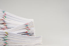 Pile overload of paperwork place on white background. Pile overload of paperwork with colorful paper clip place on white background Royalty Free Stock Photo