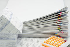 Pile overload paperwork of report with colorful paperclip. And calculator with house on finance account royalty free stock photos