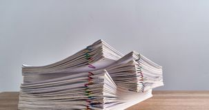 Pile overload paperwork of report on wood table time lapse stock footage