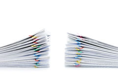 Pile overload paperwork two sets on white background. Pile overload paperwork two sets with colorful paperclip place on white background Stock Images
