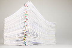Pile overload paperwork on white table Royalty Free Stock Photography