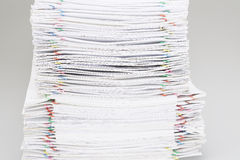 Pile of overload white paper and reports Stock Image