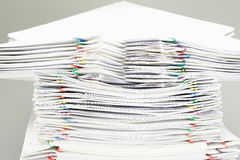 Pile of overload white paperwork and reports Stock Photo