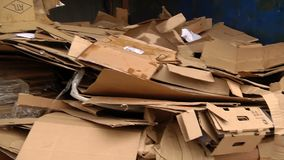 A pile of cardboard packaging ready for pressing. A pile of packing cardboard ready for pressing for further recycling stock video footage