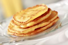 Pile of pancakes. On glass plate with limited depth of field stock photography