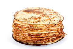 Pile of pancakes. On a plate on a white background Stock Images