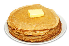 Pile of pancakes with butter Stock Photos