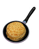 Pile of pancakes on a frying pan Stock Photo