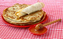 Pile of pancakes with honey Royalty Free Stock Photo