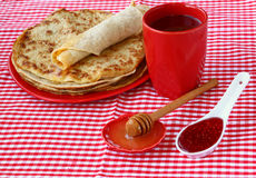 Pile of pancakes with honey Stock Image