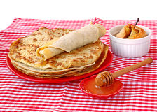 Pile of pancakes with honey and pear in a puff test Royalty Free Stock Photos