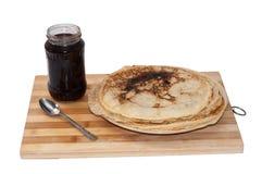 Pile of pancakes with jar of strawberry jam Royalty Free Stock Image