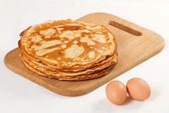 Pile of pancakes with some flour and eggs Stock Photography