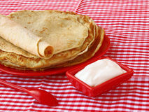 Pile of pancakes and sour cream on Shrovetide Royalty Free Stock Images
