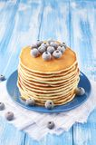 Stack of pancakes on a blue plate with frozen blueberry royalty free stock photo