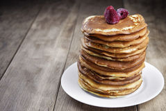 Pile of pancakes in the white plate Stock Images