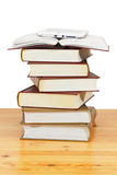 Pile of paper books and e-book Stock Photos