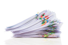 Pile of paper with colorful clips. Stack of documents with colorful clips  on white background Royalty Free Stock Photos