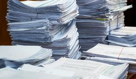 Pile of paper documents in the office. Bundles bales of paper documents. stacks packs pile on the desk in the office stock images