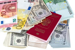 Pile of paper money and passport Royalty Free Stock Photo
