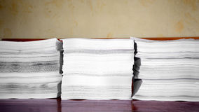 Pile of papers. On brown background Royalty Free Stock Image