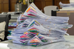 Pile of papers laid overlap on the desk Royalty Free Stock Photos