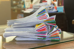 Pile of papers laid overlap on the desk Royalty Free Stock Image