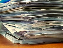 Pile of papers at office desk stock photo