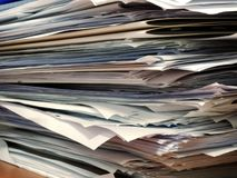 Pile of papers at office desk royalty free stock image